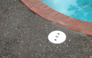 New pool skimmer avoids water leaks & surrounding pebbled deck material can be matched.