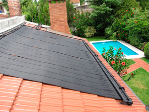 residence with pool solar heating on roof