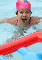 happy girl in clean pool water